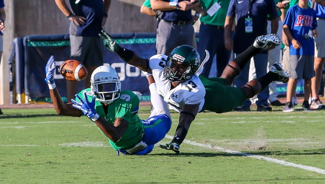 UWF's Ka'Ron Ashley (9) stretches out and tries to make the catch against Delta State defensive back Devontae Wilson (13) at Blue Wahoos Stadium on Saturday, October 14, 2017.