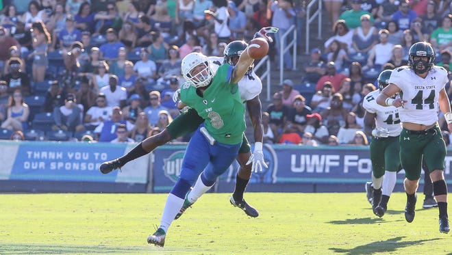 UWF's Austin Blake-Smith (8) is interefered with by Delta State's Johnquavious McBride (4) and can't make the catch at Blue Wahoos Stadium on Saturday, October 14, 2017.