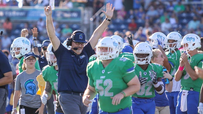 UWF head coach Pete Shinnick celebrates after an Argos touchdown against Delta State at Blue Wahoos Stadium on Saturday, October 14, 2017.