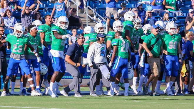 The UWF sideline celebrates after the defense stops a 4th and short play by Delta State at Blue Wahoos Stadium on Saturday, October 14, 2017.