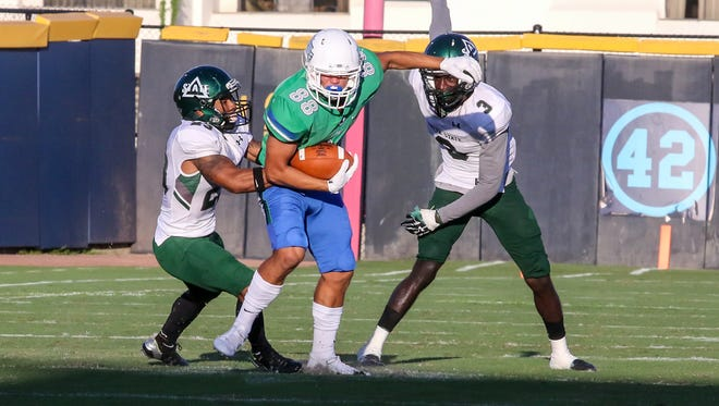 UWF's Tate Lehtio (88) tries to break free of the Delta State defenders at Blue Wahoos Stadium on Saturday, October 14, 2017.