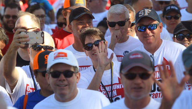 Members of the community participate in the 31st AIDS walk starting from Ruth Hardy Park in Palm Springs, on October 21, 2017. The event was organized by Desert AIDS Project.