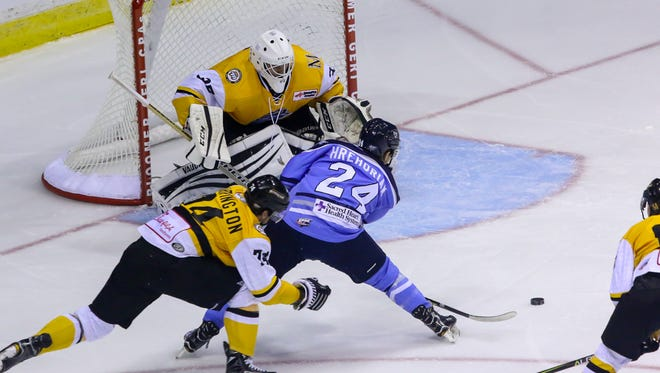 Pensacola's Stephen Hrehoriak (24) tries to line up a shot against Mississippi goaltender Tyler Green (35) during the first home game of the 2017-18 season on Friday, October 27, 2017. The Ice Flyers shut out Mississippi 2-0 and have won two straight games to start the season 2-0.