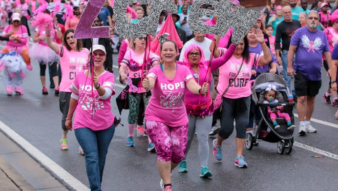 Thousands of people participate in Pensacola's 15th annual Making Strides Against Breast Cancer 5K walk on Saturday, October 28, 2017.