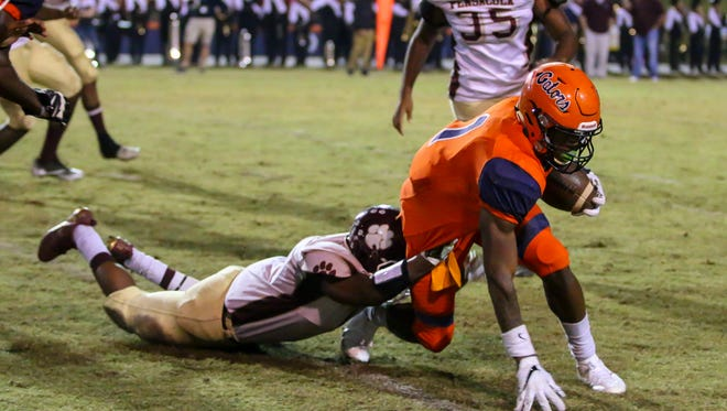 The Escambia Gators take on the Pensacola High Tigers at Escambia High School on Friday, November 3, 2017. Escambia beat PHS 31-0 and won the battle of Ye Olde Wash Bucket for the fifth straight year.