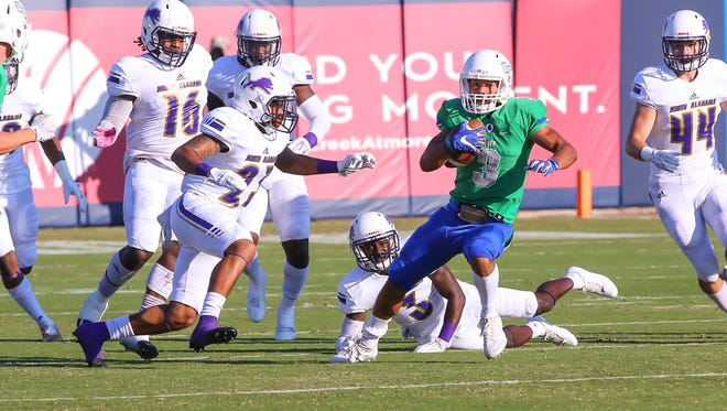 West Florida's Marcus Clayton (3) races through the North Alabama defenders on the opening kickoff at Blue Wahoos Stadium on Saturday, November 4, 2017.