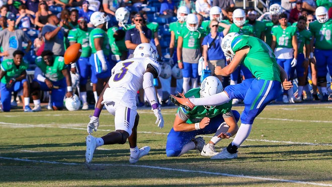 West Florida's Austin Williams (1) kicks a field goal against North Alabama at Blue Wahoos Stadium on Saturday, November 4, 2017.  West Florida recovered the ball.