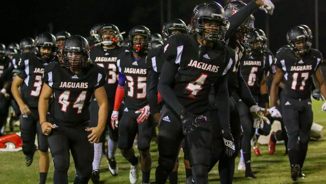 Antarrius Moultrie (No. 4) leads West Florida on to the field to face Tallahassee  Rickards in the first round of the playoffs last season. Moultrie is up to nine NCAA Division I offers and is aiming for a big senior season.