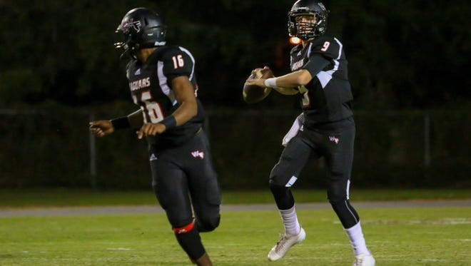 West Florida quarterback Trevor Jordan (9) looks to pass against Tallahassee Rickards in the Region 1-5A quarterfinal game at Woodham Middle School on Friday, November 10, 2017.