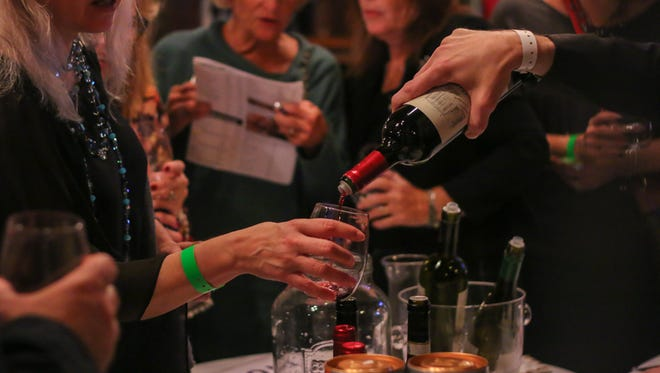 Hundreds of people enjoy a previous Seville Quarter's Wine and Food Festival. This year's event takes place Sunday.