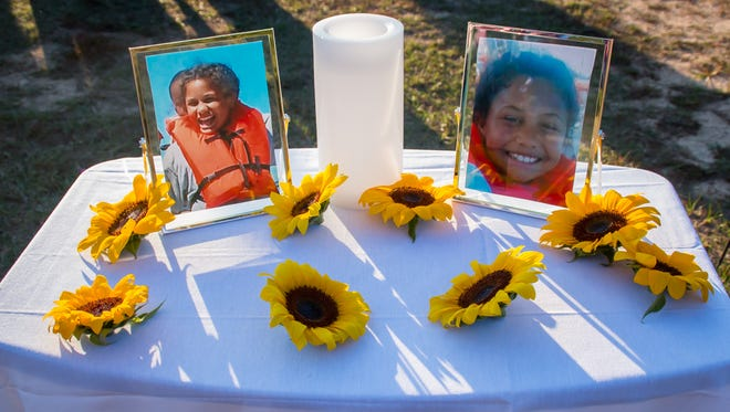 Nearly one hundred friends and teachers of 9-year-old Dericka Lindsay, a student at St. John the Evangelist School, pay their last respects to her during a memorial at Resthaven Gardens Cemetery in Pensacola on Thursday, November 16, 2017.