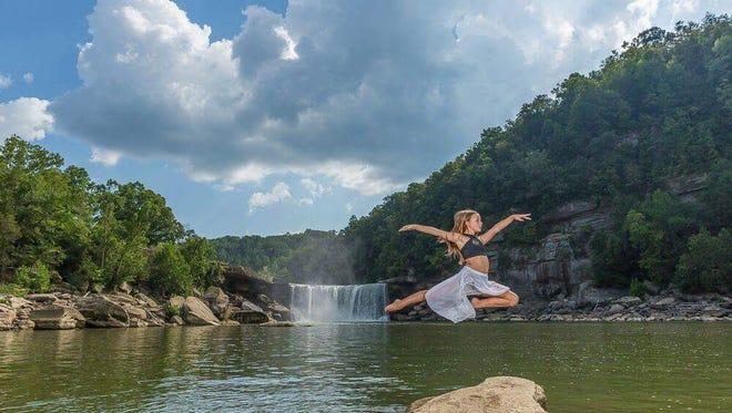 "Jennifer Ferguson of Louisville is featured dancing at Cumberland Falls, Corbin, Ky. in the book ""Dance Across the USA"""