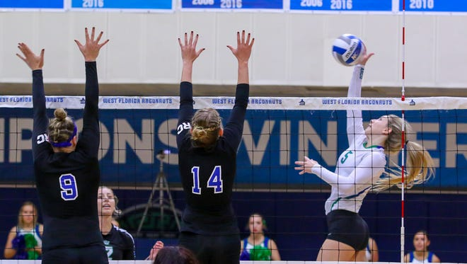 West Florida's Jordyn Poppen (5) hits the ball against Shorter's Kelsi Jones (9) and Annie Homan (14) during the Gulf South Conference semifinal volleyball game at UWF on Saturday, November 18, 2017.  The Argos won the match in three straight sets and will play for the conference championship at tomorrow at 2 p.m. at the UWF Field House.