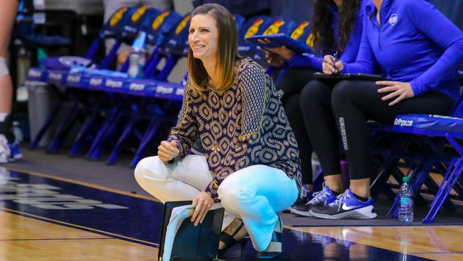 West Florida head coach Melissa Wolter smiles as her volleyball team plays Shorter University during the Gulf South Conference semifinal volleyball game at UWF on Saturday, November 18, 2017.  The Argos won the match in three straight sets and will play for the conference championship at tomorrow at 2 p.m. at the UWF Field House.