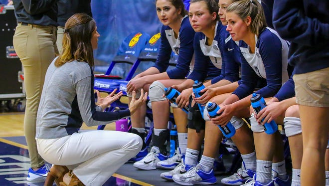 West Florida head coach Melissa Wolter talks with her team during a timeout in the Gulf South Conference volleyball championship game against North Alabama at UWF on Sunday, November 19, 2017. After losing to UNA in the conference championship game the previous two years, UWF beat their nemesis in three straight sets (25-19, 25-13, 25-17).