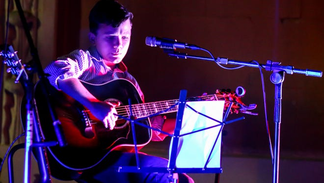 Ben Kennington, 12, a Youth Music Project scholarship winner, performs during Gallery Night in November.