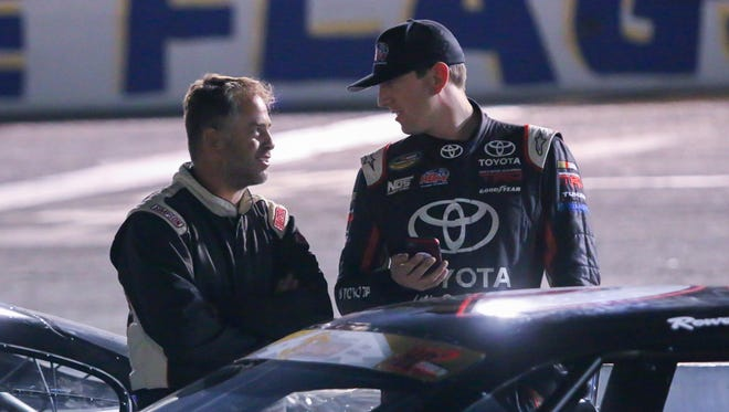 Preston Peltier, left, chats with NASCAR racer Kyle Busch after completing their qualifying laps for the 50th annual Snowball Derby at Five Flags Speedway on Friday, December 1, 2017. Peltier finished first with the fastest lap time of 16.319 and Busch finished 15th with a lap time of 16.530.