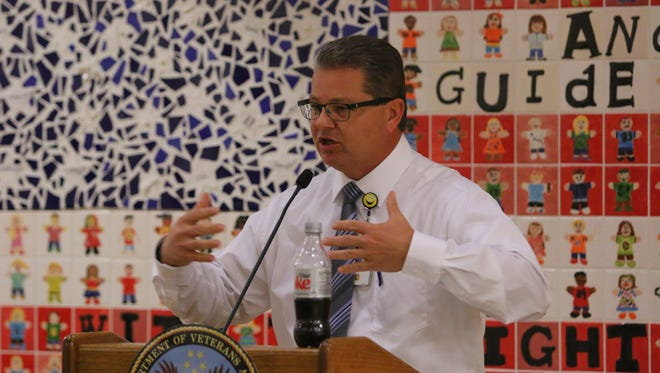Ray Bowne, Gulf Coast Veterans Health Care System veterans health education coordinator, speaks during a town hall at the Joint Ambulatory Care Center on Wednesday, Dec. 6, 2017.