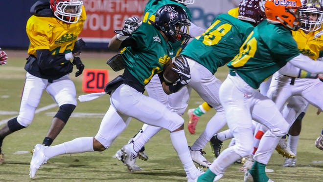 West Florida High's Keyshawn Helton (5) follows his blockers and runs up the field during the 2017 Subway High School All-Star football game at Blue Wahoos Stadium on Friday, December 15, 2017.