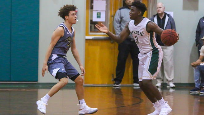 Catholic's Jakobi Jackson (3) looks for his next move against Foley in their quarterfinal game during the 6th annual Crusader Classic at Catholic High School on Wednesday, December 27, 2017. Catholic won 70-48 and will face West Florida in the semifinals on Thursday.