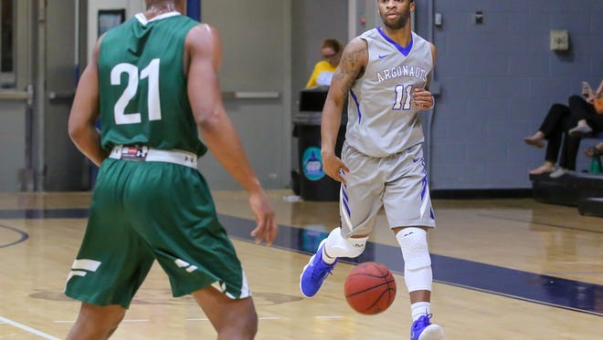 UWF's Rashaan Benson (11) brings the ball into play against conference rival Delta State at the University of West Florida Field House on Tuesday, January 9, 2018.