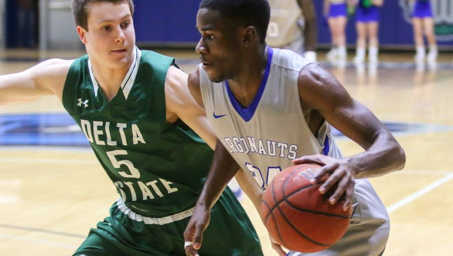 UWF's DJ Thorpe (24) races past Delta State's Matthew Wilson (5) toward the basket at the University of West Florida Field House on Tuesday, January 9, 2018.