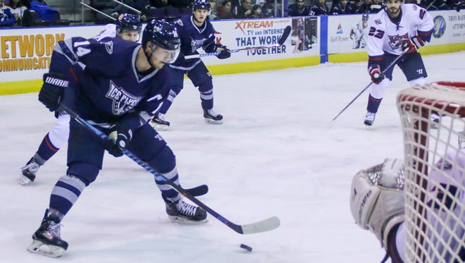 Pensacola's Trever Hertz (14) gets a pass and prepares to take a shot against Macon goaltender Charlie Finn (33) at the Pensacola Bay Center on Sunday, January 14, 2018. Though Macon won the game 4-2, the Ice Flyers have won three of their last five games and stay in first place with 43 points.
