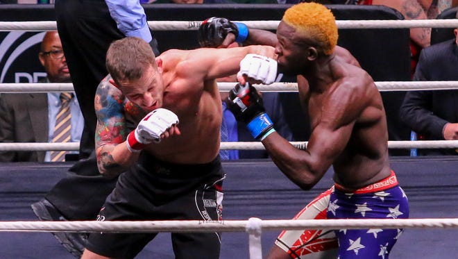 Max Mustaki, red tape, takes on Socrates Pierre during Island Fights 46 at the Pensacola Bay Center on Thursday, February 8, 2018. Mustaki won by TKO in the first round.