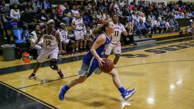 Washington's Kenzie Hughes (25) tries to make her way inside against PHS in the District 1-7A championship game at Milton High School on Saturday, Feb. 10, 2018.