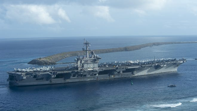 USS Carl Vinson pulls into Apra Harbor, Guam for a port visit Jan. 31. The ship is currently deployed in the 7th Fleet area of operation.