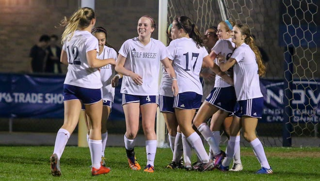 The Gulf Breeze players celebrate after Kristen Goodroe scores the second goal against Lecanto in the FHSAA class 3A state semifinal game at Gulf Breeze High School on Friday, Feb. 16, 2018. The Dolphins won 2-0 and will travel to DeLand to face Merritt Island for the state championship on Friday, Feb. 23.