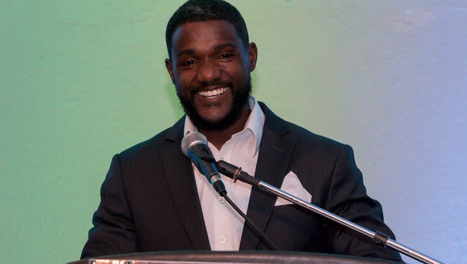 Woodhman High School graduate and world champion sprinter Justin Gatlin is all smiles after his mom stood up to take a picture of him speaking during the 64th annual Pensacola Sports Awards Banquet at New World Landing on Tuesday, Feb. 20, 2018. The awards were given to athletes, coaches and notables for their achievements or involvement in Pensacola-area sports. He was named the 2017 Professional Athlete of the Year by Pensacola Sports and also was the guest speaker.
