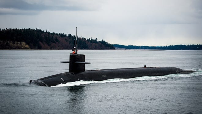 A subcontractor working on a seismic upgrade at the Delta Pier Support Facility at Naval Base Kitsap-Bangor billed the Navy for work done at the owner's Gig Harbor home. The USS Kentucky, shown here, is one of the submarines homeported at Bangor.
