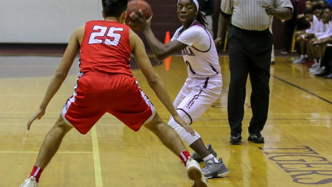 Pensacola High's Angelo Bascomb (3) prepares to pass the ball against Crestview's Chris Basil (25) in the FHSAA Region 1-7A quarterfinal game at PHS on Thursday, Feb. 22, 2018.