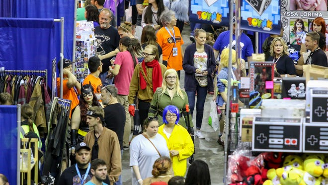 People make their way to and through the Pensacola Bay Center on the final day of last year's Pensacon. This year's convention begins this weekend.
