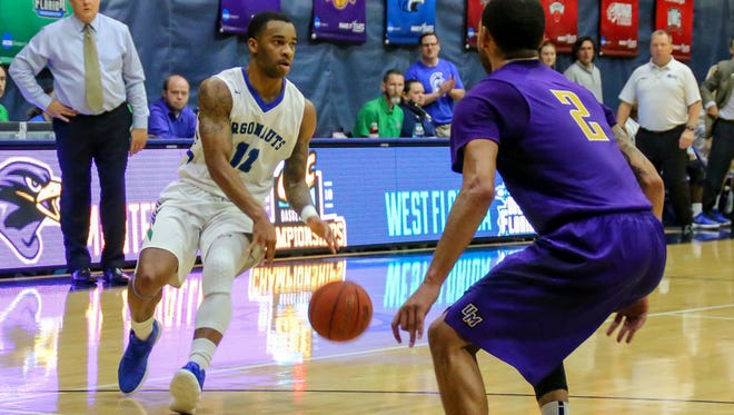 UWF's Rashaan Benson (11) moves the ball into the offensive zone against Montevallo during a Gulf South Conference Tournament game at the University of West Florida Field House on Tuesday, Feb. 27, 2018. Seeded number two, UWF beat #7 Montavello 83-74.