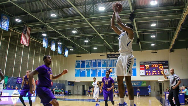 UWF's Marvin Jones (4) goes for three against Montevallo during a Gulf South Conference Tournament game at the University of West Florida Field House on Tuesday, Feb. 27, 2018. UWF is hosting its annual basketball camps in the UWF Field House in August.