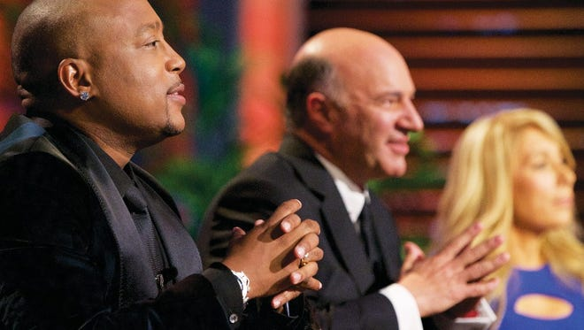 """Daymond John, Kevin O'Leary and Lori Greiner listen to Radzely's pitch on ABC's """"Shark Tank"""""""