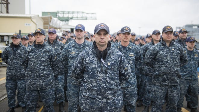 BREMERTON, Wash. (April 4, 2018) The final crew of the Los Angeles-class fast-attack submarine USS Dallas (SSN 700) stands at parade rest as the ship is decommissioned at the Puget Sound Naval Shipyard (PSNS). Dallas concluded 38 years of service as the second U.S. Navy warship to be named after Dallas, Texas.