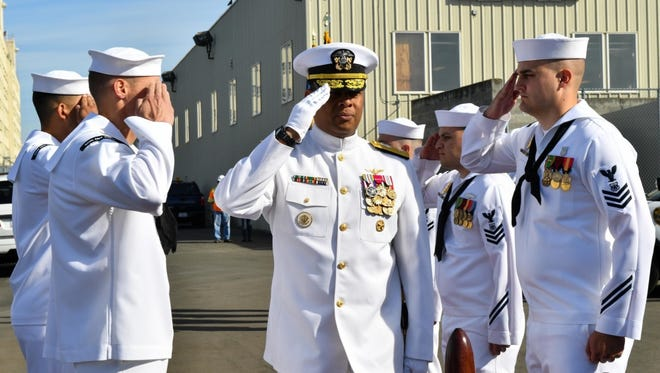 Rear Adm. Gary Mayes, commander, Navy Region Northwest is saluted by sideboys during a change of command ceremony in 2016.