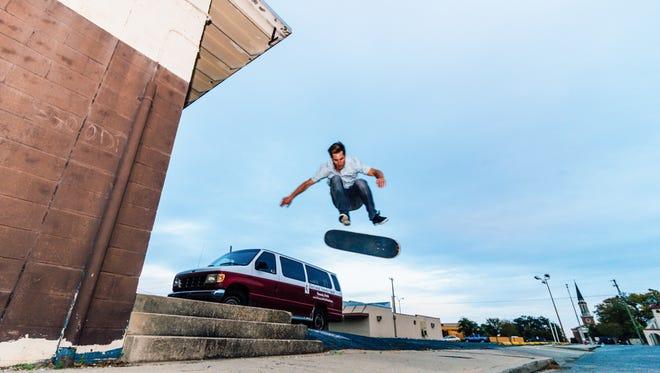 Jon Shell performs a kickflip in downtown Pensacola.