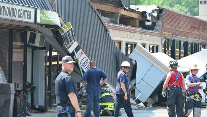 Emergency personnel are at the scene of the collapse of the facade of a strip mall at the Kress Plaza in River Edge on Tuesday morning July 3, 2018.