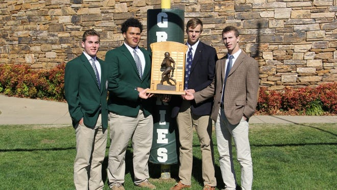 Captains for the Asheville School and Christ School football teams.