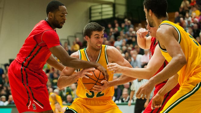 Hartford's Mark Nwakamma (1) battles for the rebound with Catamounts forward Ethan O'Day (32) during the men's basketball game between the Hartford Hawks and the Vermont Catamounts at patrick Gym on Wednesday night December 3, 2014 in Burlington.