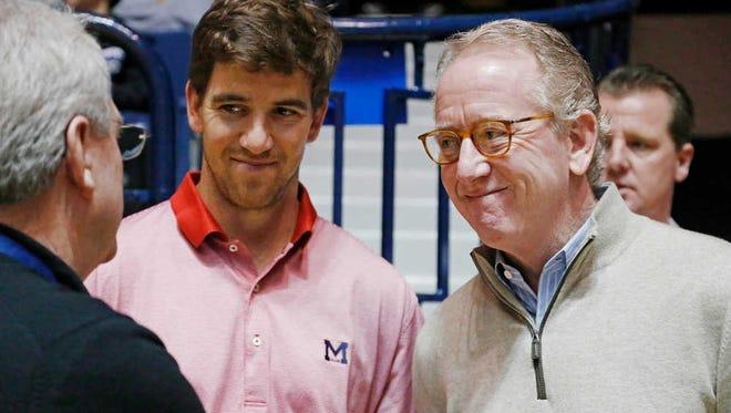 Ole Miss legend Archie Manning, right, is stepping down from the college football playoff selection committee.