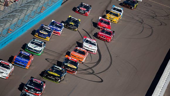 NASCAR drivers begin the first lap at the Phoenix International Raceway during the Sprint Cup Nationwide Series race November 8, 2014 in Avondale.