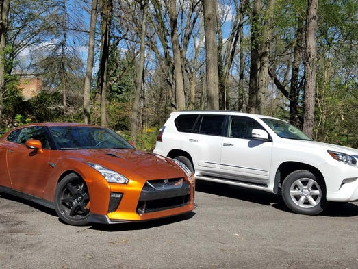 Driveway dinosaurs. The Nissan GT-R supercar, left,
