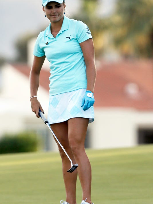 Lexi Thompson reacts after missing an eagle putt on the 18th hole that would have won the LPGA Tour's ANA Inspiration golf tournament at Mission Hills Country Club, in Rancho Mirage, Calif., Sunday, April 2, 2017. Instead she made birdie putt to force a playoff against So Yeon Ryu, of South Korea. Ryu won the playoff on the first hole. (AP Photo/Alex Gallardo)