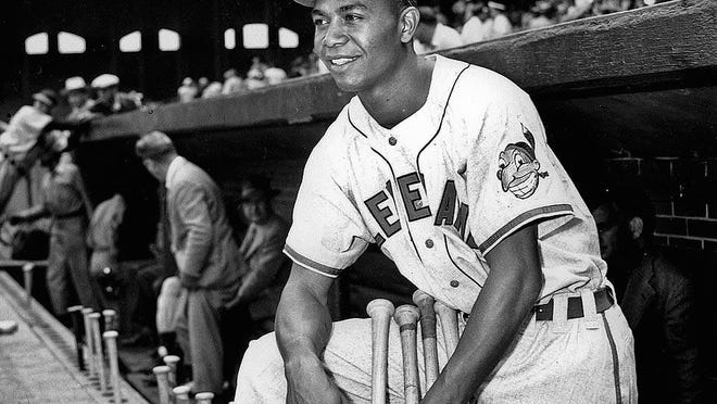 Larry Doby, first black in the American League, poses proudly in his Cleveland Indians uniform in the dugout in Comiskey Park in Chicago, Ill., on July 5, 1947.