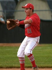 West Lafayette's Spencer Ronchetto scoops up the ball.